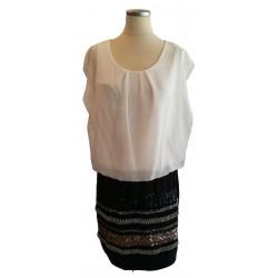 White top on black short skirt